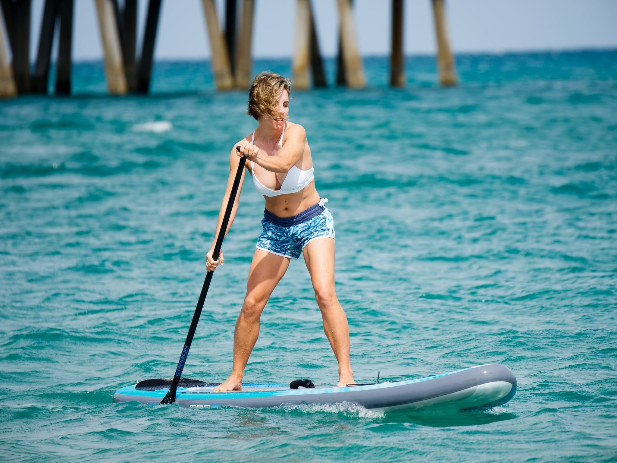 Girl holding the best inflatable paddle board