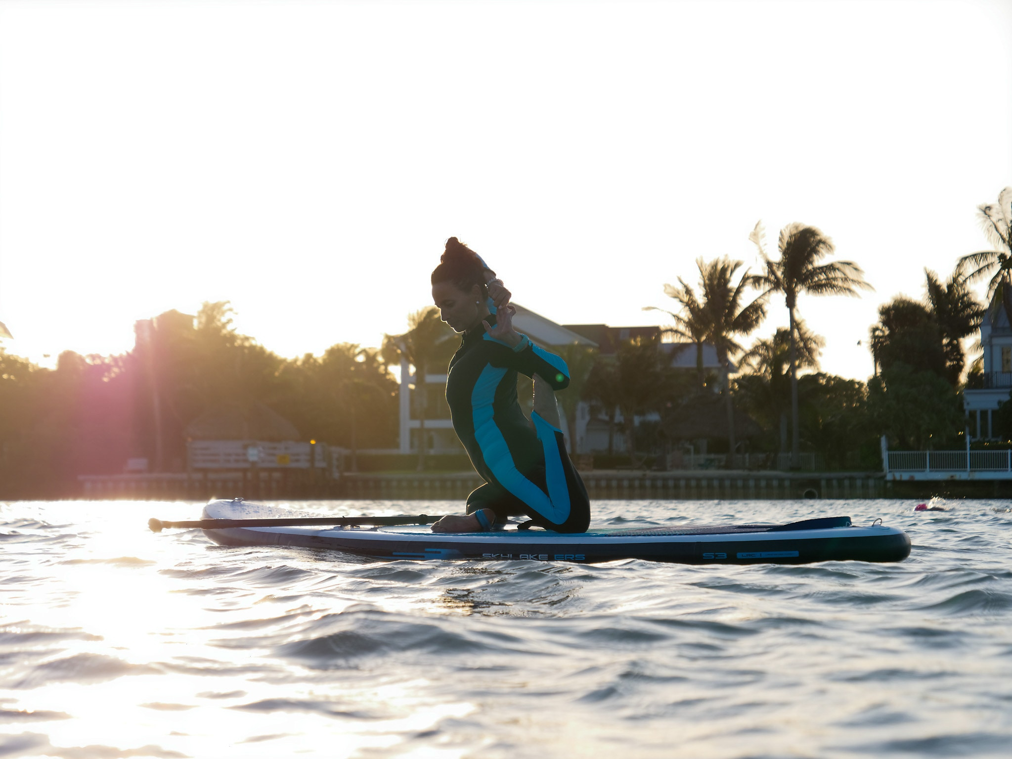 Yoga on an inflatable SUP board
