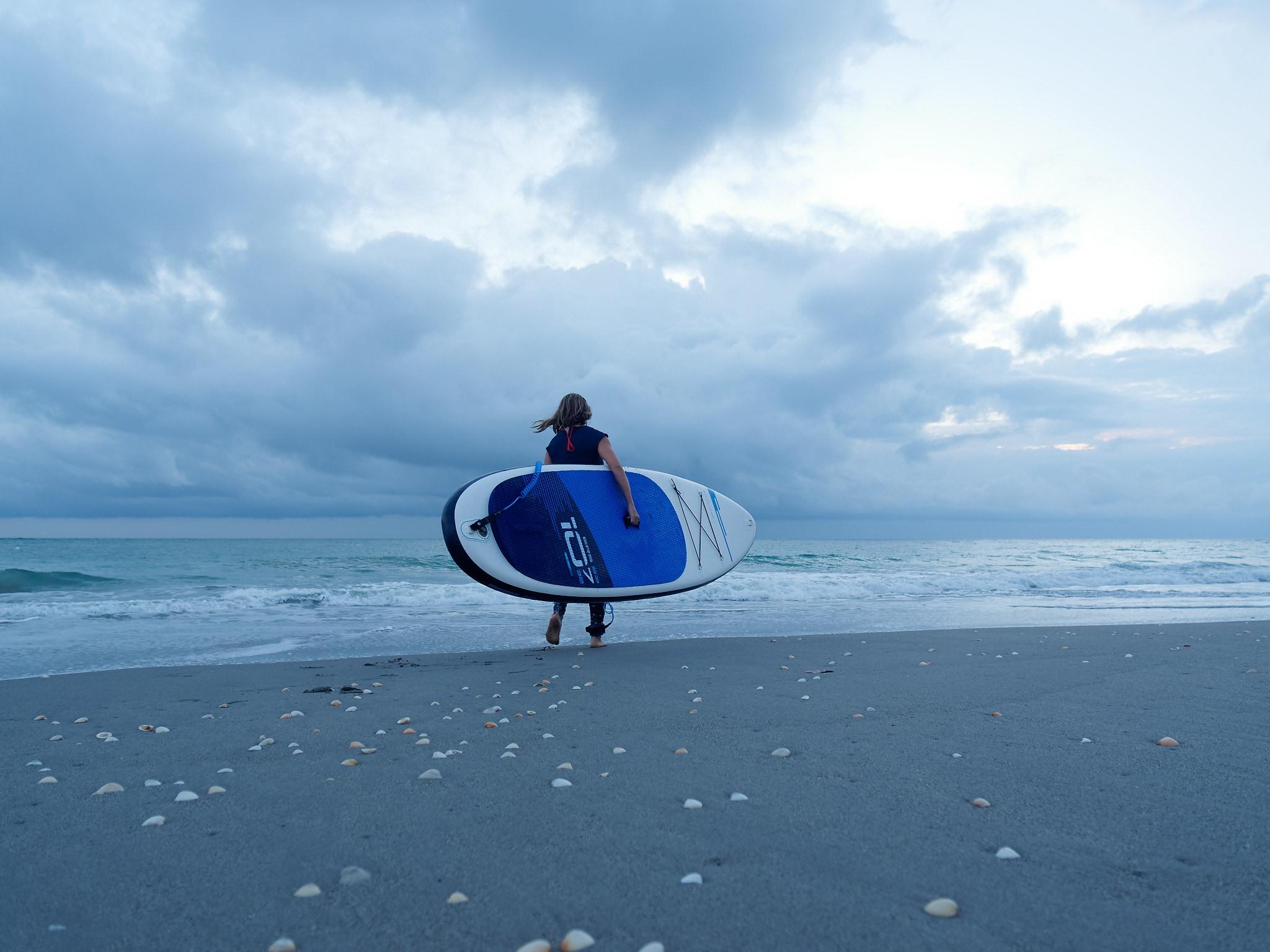 Ocean paddler near shoreline and waves