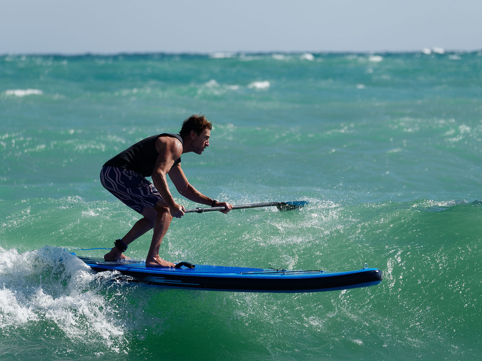 Paddling on a wave on an SUP