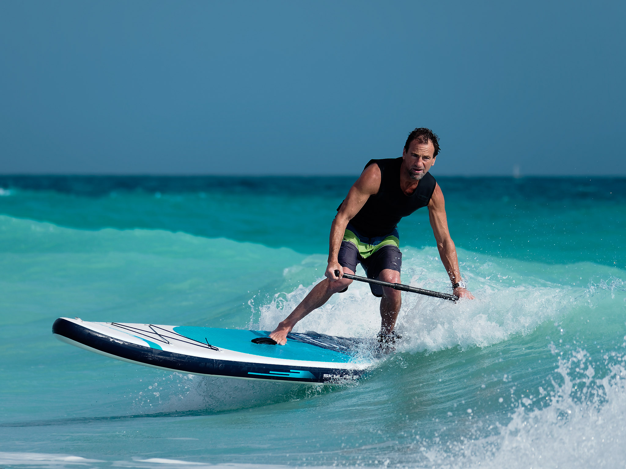 Man surfing an inflatable SUP