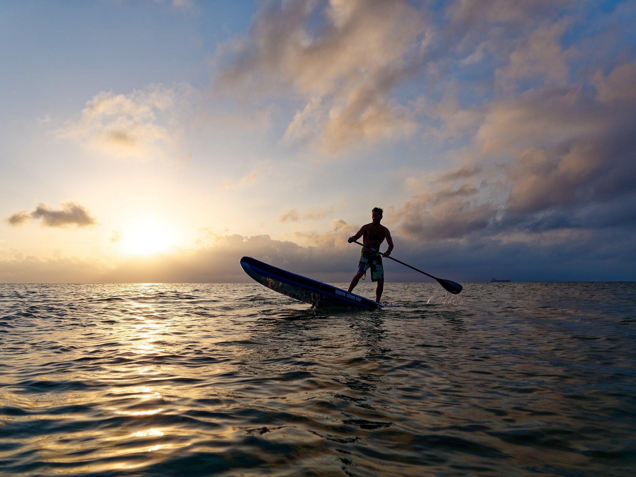 SUP tail drop on the coast at sunrise